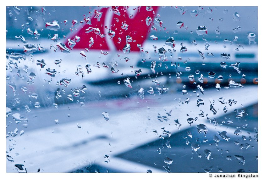 Raindrops on the window of a plane.