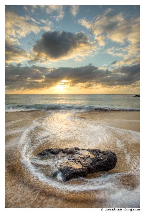 Rock on Papohaku beach, Molokai, Hawaii (tonemapped HDR image).