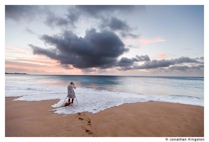 Dewitt Jones photographing waves, Papohaku beach, Molokai Hawaii.