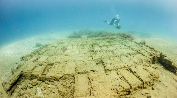 Diver over the hull of a 17th century shipwreck in Panamanian waters.